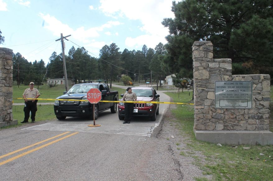 Security guards are stationed at the entrance to the Sunspot Solar Observatory to turn away the visitors curious about the site's sudden closure Friday, Sept. 14, 2018, in Sunspot, N.M. Authorities remain tightlipped Friday, saying only that an undisclosed security concern was behind the decision to abruptly vacate and lock up the remote facility on Sept 6. (Dylan Taylor-Lehman/Alamogordo Daily News via AP)