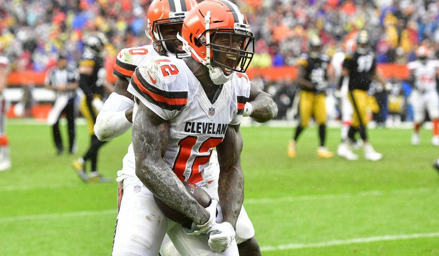 Cleveland Browns receiver Josh Gordon (12) celebrates his touchdown reception during an NFL football game against the Pittsburgh Steelers, Sunday, Sept. 9, 2018, in Cleveland. The Browns and the Steelers tied at 21-21. (AP Photo/David Richard) ** FILE **
