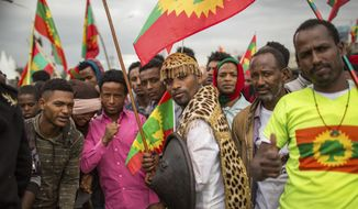 Ethiopians wearing traditional Oromo costume gather to welcome returning leaders of the once-banned Oromo Liberation Front (OLF) in the capital Addis Ababa, Ethiopia Saturday, Sept. 15, 2018. The OLF and two other organizations were removed from a list of terror groups earlier this year after Prime Minister Abiy Ahmed took office, amid sweeping reforms to bring opposition groups back to politics. (AP Photo/Mulugeta Ayene)