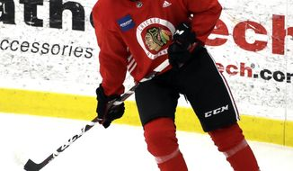 Chicago Blackhawks forward Nick Schmaltz waits for pass during NHL hockey training camp at the MB Ice Arena, Friday, Sept. 14, 2018, in Chicago. (AP Photo/Nam Y. Huh)