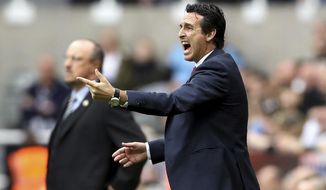 Arsenal manager Unai Emery gestures on the touchline during the English Premier League soccer match between Newcastle United and Arsenal at St James' Park, in Newcastle, England, Saturday, Sept. 15, 2018. (Owen Humphreys/PA via AP)