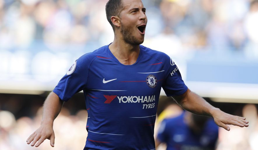 Chelsea's Eden Hazard celebrates scoring his side's first goal during their English Premier League soccer match between Chelsea and Cardiff City at Stamford Bridge stadium in London Saturday, Sept. 15, 2018. (AP Photo/Alastair Grant)