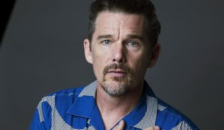 """In this Sept. 6, 2018 photo, actor-director Ethan Hawke poses for a portrait in New York to promote his film """"Blaze."""" (Photo by Amy Sussman/Invision/AP)"""