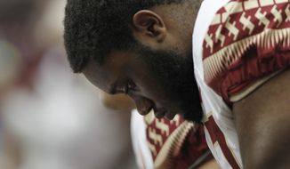 Florida State's Christian Armstrong reacts on the bench late in the fourth quarter of an NCAA college football game against Syracuse in Syracuse, N.Y., Saturday, Sept. 15, 2018. (AP Photo/Nick Lisi)