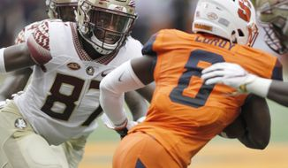 Florida State's Camren McDonald, left, looks to tackle Syracuse's Antwan Cordy, right, in the first quarter of an NCAA college football game in Syracuse, N.Y., Saturday, Sept. 15, 2018. (AP Photo/Nick Lisi)