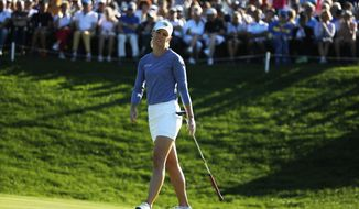 Amy Olson of the U.S. reacts after putting on the 18th hole during the third round of the Evian Championship women's golf tournament in Evian, eastern France, Saturday, Sept. 15, 2018. (AP Photo/Francois Mori)