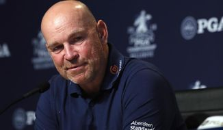 FILE - In this Tuesday, Aug. 7, 2018 file photo, Thomas Bjorn, of Denmark, captain of the 2018 European Ryder Cup team, speaks during a news conference at the PGA Championship golf tournament, at Bellerive Country Club in St. Louis. Bjorn, has welcomed the inclusion of Tiger Woods in the United States team, saying it will be good for the event which takes place outside Paris Sept. 28-30. (AP Photo/Jeff Roberson, File)