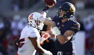 California quarterback Chase Garbers, right, passes against Idaho State during the second half of an NCAA college football game Saturday, Sept. 15, 2018, in Berkeley, Calif. (AP Photo/Ben Margot)