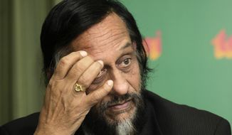 FILE- In this Jan. 21, 2010 file photo, the U.N. Intergovernmental Panel on Climate Change (IPCC) head Rajendra Pachauri looks on at a press conference in New Delhi, India. An Indian court ruled on Friday, Sept. 14, 2018, there is enough evidence to send India's former U.N. climate chief Pachauri to trial on charges of stalking and sexual harassment in a case filed by a former female colleague in New Delhi. (AP Photo/Gurinder Osan, File)