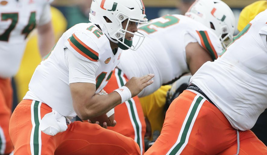 Miami quarterback Malik Rosier (12) carries for a touchdown behind his blockers during the first quarter of an NCAA college football game against Toledo Saturday, Sept. 15, 2018, in Toledo, Ohio. (AP Photo/Duane Burleson)