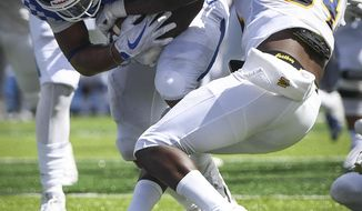 Kentucky running back Benny Snell Jr. scores a touchdown as he is tackled by Murray State defensive back Marquez Sanford (34) during the first half an NCAA college football game in Lexington, Ky., Saturday, Sept. 15, 2018. (AP Photo/Bryan Woolston)