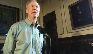 FILE - In this Aug. 9, 2018, file photo, Illinois Gov. Bruce Rauner speaks to the news media in his state Capitol office, in Springfield, Ill. Two weeks after Education Secretary Betsy DeVos called her friend, Gov. Bruce Rauner, in August 2017, the Illinois Republican vetoed legislation creating protections for students taking out federal loans. Lawmakers reversed the veto, but the phone call underscores the first-term governor's interaction with Trump while trying to distance himself from a president hugely unpopular in Democratic Illinois. (AP Photo/John O'Connor File)
