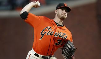 San Francisco Giants starting pitcher Chris Stratton (34) throws against the Colorado Rockies during the first inning of a baseball game in San Francisco, Friday, Sept. 14, 2018. (AP Photo/Tony Avelar)