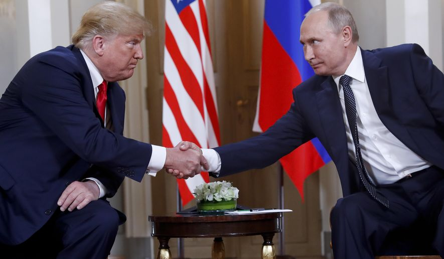 In this file photo taken on Monday, July 16, 2018, U.S. President Donald Trump, left, and Russian President Vladimir Putin, right, shake hand at the beginning of a meeting at the Presidential Palace in Helsinki, Finland. (AP Photo/Pablo Martinez Monsivais)