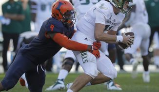 South Florida's Blake Barnett, right, is sacked by Illinois's Dele Harding during the second half of an NCAA college football game Saturday, Sept. 15, 2018, in Chicago. (AP Photo/Jim Young)