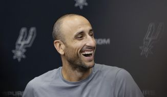 Former San Antonio Spurs guard Manu Ginobili jokes with the media at the NBA basketball team's practice facility, Saturday, Sept. 15, 2018, in San Antonio. Ginobili recently retired at age 41 after 16 seasons with the Spurs and helping them win four NBA championships. (AP Photo/Eric Gay)