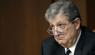 Sen. John Kennedy, R-La., listens to answer to his question of Department of Justice Inspector General Michael Horowitz and FBI Director Christopher Wray during a hearing of the Senate Judiciary Committee to examine Horowitz's report of the FBI's Clinton email probe, on Capitol Hill, Monday, June 18, 2018 in Washington. (AP Photo/Alex Brandon)