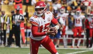 Kansas City Chiefs quarterback Patrick Mahomes (15) scrambles against the Pittsburgh Steelers in the first half of an NFL football game, Sunday, Sept. 16, 2018, in Pittsburgh. (AP Photo/Gene J. Puskar)