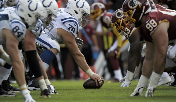The line of scrimmage during an NFL football game between the Indianapolis Colts and Washington Redskins, Sunday, Sept. 16, 2018, in Landover, Md. (AP Photo/Mark Tenally)