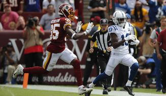 Indianapolis Colts wide receiver T.Y. Hilton, right, rushes past Washington Redskins defensive back Montae Nicholson in the first half of an NFL football game, Sunday, Sept. 16, 2018, in Landover, Md. (AP Photo/Carolyn Kaster)