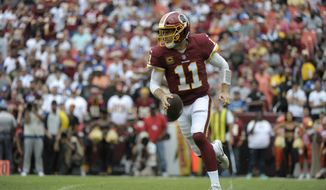 Washington Redskins quarterback Alex Smith scrambles during an NFL football game against the Indianapolis Colts, Sunday, Sept. 16, 2018, in Landover, Md. (AP Photo/Mark Tenally)