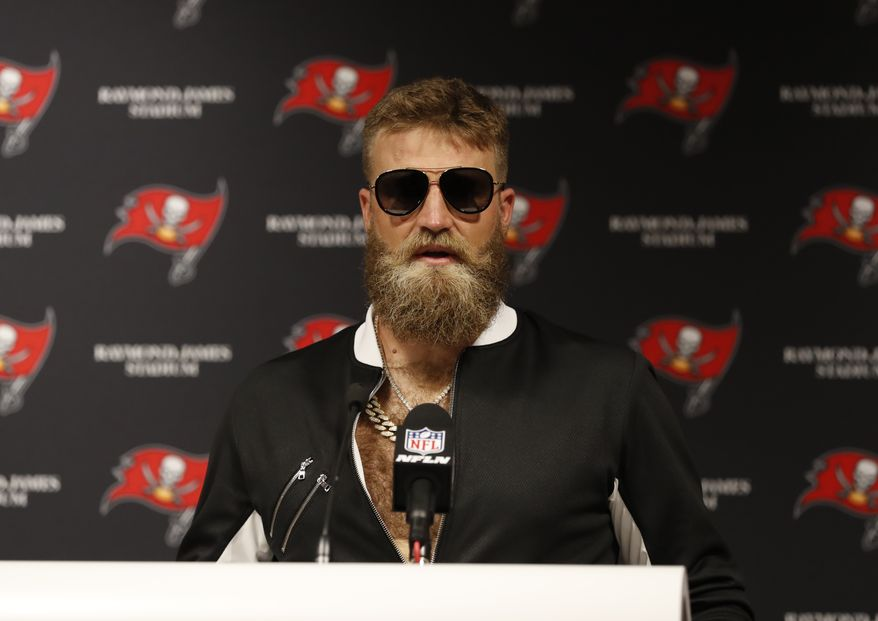 Tampa Bay Buccaneers quarterback Ryan Fitzpatrick talks during a post game news conference following an NFL football game against the Philadelphia Eagles, Sunday, Sept. 16, 2018, in Tampa, Fla. The Buccaneers defeated the Eagles 27- 21. (AP Photo/Mark LoMoglio)