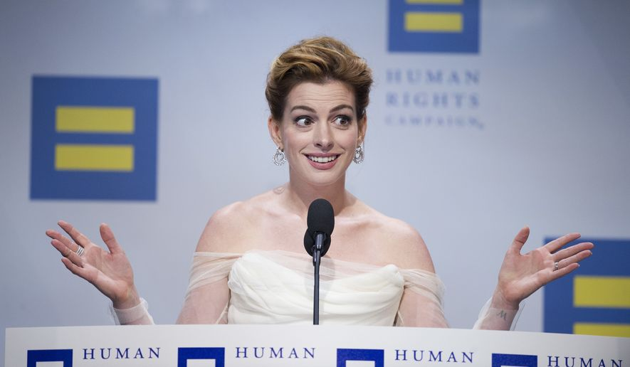 Actress Anne Hathaway addresses the Human Rights Campaign (HRC) National Dinner after receiving the group's National Equality Award, in Washington, Saturday, Sept. 15, 2018. (AP Photo/Cliff Owen)
