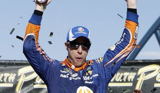 Brad Keselowski celebrates after winning a NASCAR Cup Series auto race Sunday, Sept. 16, 2018, in Las Vegas. (AP Photo/Isaac Brekken)