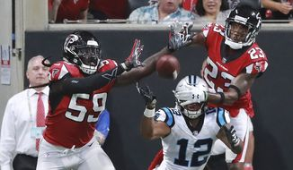 Atlanta Falcons defenders De'Vondre Campbell, left, and Robert Alford break up the final pass of the game to Carolina Panthers D.J. Moore during the fourth quarter of an NFL football game on Sunday, Sept 16, 2018, in Atlanta. (Curtis Compton/Atlanta Journal-Constitution via AP)