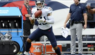 Tennessee Titans defensive back Dane Cruikshank catches a pass on a fake punt play as he runs 66 yards for a touchdown against the Houston Texans in the first half of an NFL football game Sunday, Sept. 16, 2018, in Nashville, Tenn. (AP Photo/Mark Zaleski) ** FILE **