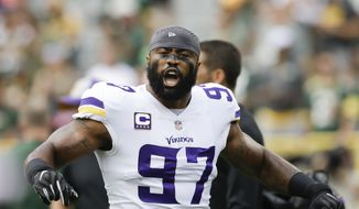 Minnesota Vikings' Everson Griffen warms up before an NFL football game against the Green Bay Packers Sunday, Sept. 16, 2018, in Green Bay, Wis. (AP Photo/Jeffrey Phelps) ** FILE **