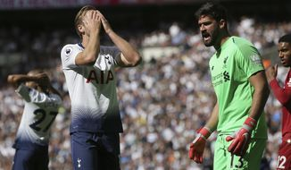 Tottenham's Harry Kane, 2nd from left reacts after he failed to score during the English Premier League soccer match between Tottenham Hotspur and Liverpool at Wembley Stadium in London, Saturday Sept. 15, 2018. (AP Photo/Tim Ireland)