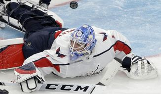 Washington Capitals' Pheonix Copley hits the ice while deflecting the puck in the second period of an NHL preseason hockey game against the Boston Bruins, Sunday, Sept. 16, 2018, in Boston. (AP Photo/Steven Senne) ** FILE **