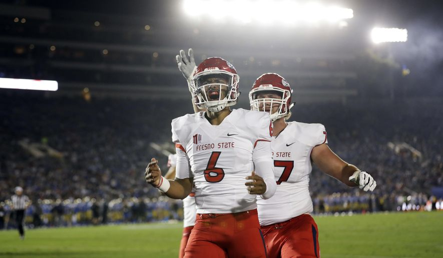 Fresno State quarterback Marcus McMaryion (6) celebrates after scoring a rushing touchdown against UCLA during the first half of an NCAA college football game Saturday, Sept. 15, 2018, in Pasadena, Calif. (AP Photo/Marcio Jose Sanchez)