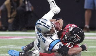 Atlanta Falcons safety Damontae Kazee (27) levels Carolina Panthers quarterback Cam Newton (1) during the second quarter of an NFL football game Sunday, Sept. 16, 2018, in Atlanta. Kazee was ejected from the game for the hit. (Curtis Compton/Atlanta Journal-Constitution via AP)