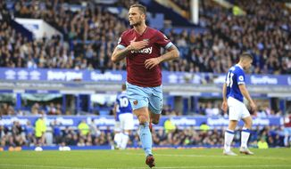 West Ham United's Marko Arnautovic celebrates scoring his side's third goal of the game,  during the English Premier League soccer match between Everton and West Ham United, at Goodison Park, Liverpool, England, Sunday Sept. 16, 2018. (Peter Byrne/PA via AP)