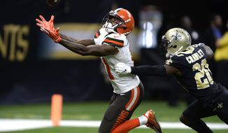 Cleveland Browns wide receiver Antonio Callaway, left, prepares to catch the ball for a touchdown over New Orleans Saints cornerback Ken Crawley during the second half of an NFL football game in New Orleans, Sunday, Sept. 16, 2018. (AP Photo/Bill Feig)