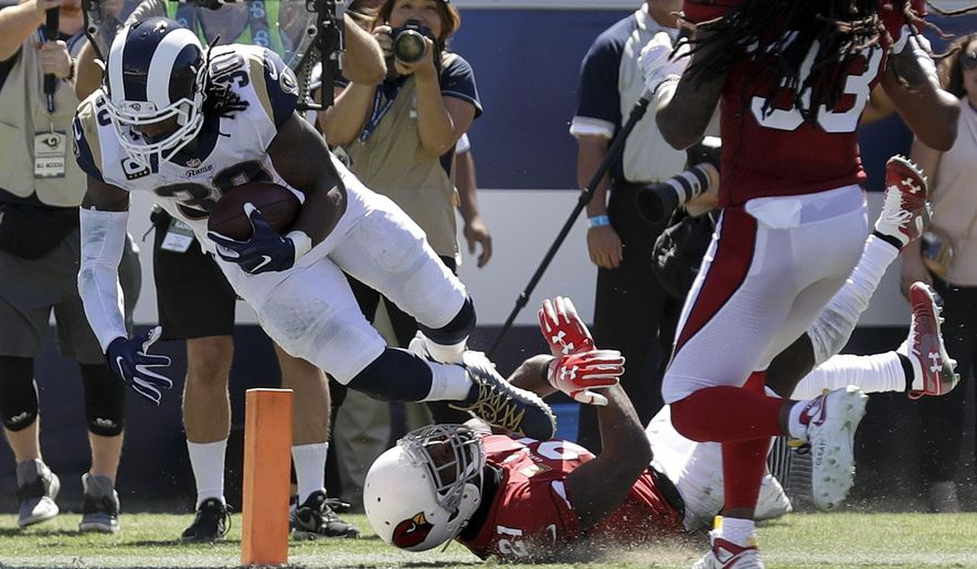 Los Angeles Rams running back Todd Gurley scores past Arizona Cardinals defensive back Patrick Peterson during the first half of an NFL football game Sunday, Sept. 16, 2018, in Los Angeles. (AP Photo/Marcio Jose Sanchez)