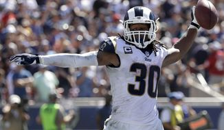 Los Angeles Rams running back Todd Gurley celebrates after scoring during the first half of an NFL football game against the Arizona Cardinals Sunday, Sept. 16, 2018, in Los Angeles. (AP Photo/Marcio Jose Sanchez)
