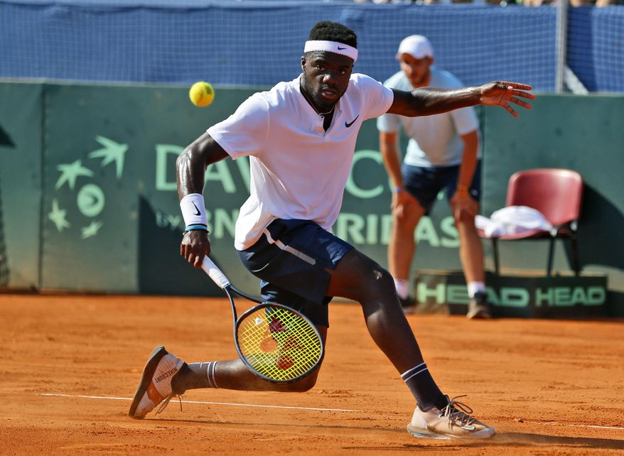 Frances Tiafoe of the United States returns a shot to Croatia's Borna Coric during their Davis Cup semifinal singles match between Croatia and the United States in Zadar, Croatia, Sunday, Sept. 16, 2018. (AP Photo/Darko Bandic) ** FILE **