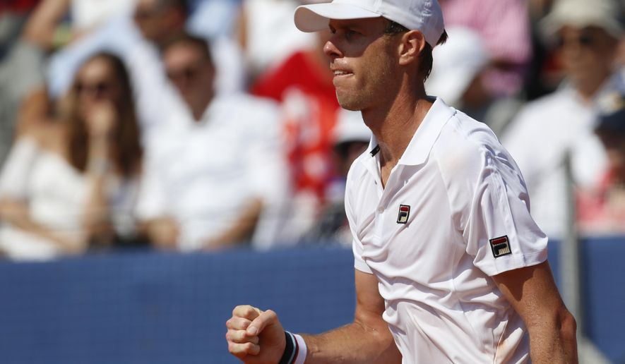Sam Querrey of the United States reacts after winning a point against Marin Cilic of Croatia during their Davis Cup semifinal singles match in Zadar, Croatia, Sunday, Sept. 16, 2018. (AP Photo/Darko Bandic)