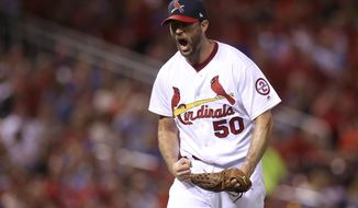 St. Louis Cardinals starting pitcher Adam Wainwright (50) reacts after striking out Los Angeles Dodgers' Joc Pederson to end the top of the fifth inning of a baseball game Sunday, Sept. 16, 2018 in St. Louis. (AP Photo/Scott Kane)