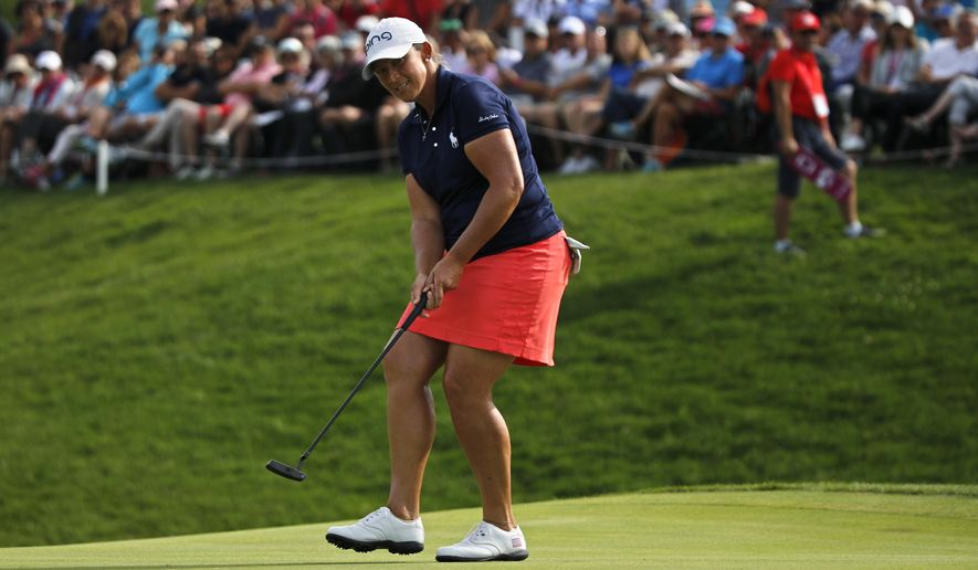 Angela Stanford of the U.S. puts on the 18th green during the fourth round of the Evian Championship women's golf tournament in Evian, eastern France, Sunday, Sept. 16, 2018. (AP Photo/Francois Mori)