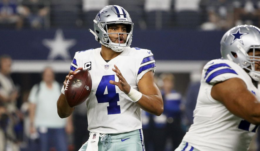 Dallas Cowboys quarterback Dak Prescott (4) looks to throw against the New York Giants during the first half of an NFL football game in Arlington, Texas, Sunday, Sept. 16, 2018. (AP Photo/Michael Ainsworth)