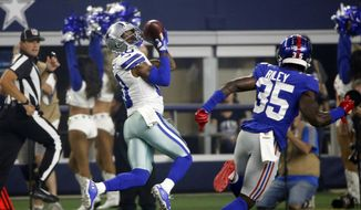 Dallas Cowboys wide receiver Tavon Austin (10) pulls in a pass in front of New York Giants cornerback Curtis Riley (35) to score a 64-yard touchdown during the first half of an NFL football game in Arlington, Texas, Sunday, Sept. 16, 2018. (AP Photo/Michael Ainsworth)