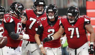 Atlanta Falcons quarterback Matt Ryan (2) celebrates his touchdown with team mates during the second half of an NFL football game against the Carolina Panthers, Sunday, Sept. 16, 2018, in Atlanta. (AP Photo/John Bazemore)