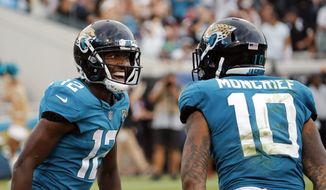 Jacksonville Jaguars wide receiver Dede Westbrook (12) celebrates his 61-yard touchdown against the New England Patriots with teammate wide receiver Donte Moncrief (10) during the second half of an NFL football game, Sunday, Sept. 16, 2018, in Jacksonville, Fla. (AP Photo/Stephen B. Morton) **FILE**