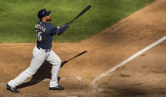 Milwaukee Brewers' Domingo Santana hits a home run against the Pittsburgh Pirates during the ninth inning of a baseball game Sunday, Sept. 16, 2018, in Milwaukee. (AP Photo/Darren Hauck)