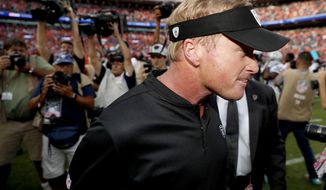 Oakland Raiders head coach Jon Gruden leaves the field after an NFL football game against the Denver Broncos, Sunday, Sept. 16, 2018, in Denver. The Broncos won 20-19. (AP Photo/David Zalubowski)