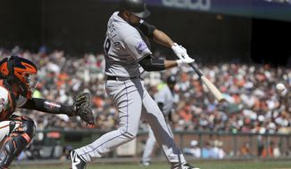 Colorado Rockies' Antonio Senzatela (49) connects for a two-RBI single in the second inning against the San Francisco Giants in a baseball game in San Francisco, Sunday, Sept. 16, 2018. (AP Photo/Scot Tucker)